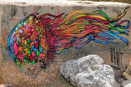 SETE, FRANCE - September 21, 2014:  Graffiti  Jellyfish on a stones of a breakwater in Sete, south of France