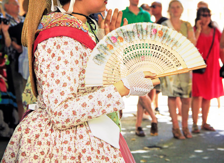 People dressed up in traditional medieval Provencial clothes dancing at the street in Provence photo