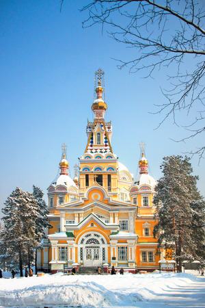 alma: Russian Orthodox cathedral located in Panfilov Park in Almaty, Kazakhstan. Completed in 1907, it is the second tallest wooden building in the world. Stock Photo