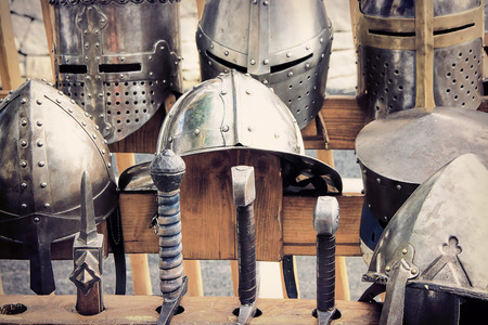Armor knight Medieval, helmets and swords. photo