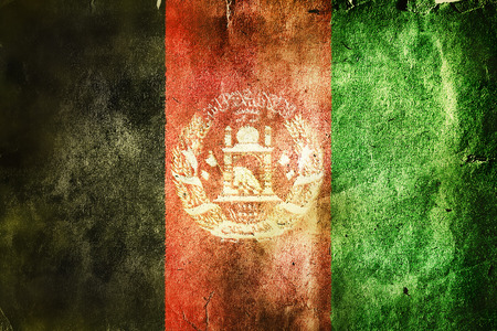 afghan flag: flag of Afghanistan. Old vintage paper texture. Stock Photo
