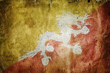 flag of Bhutan. Old vintage paper texture. Stock Photo