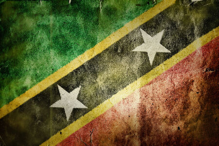 christopher columbus: flag of Saint Kitts and Nevis. Old vintage paper texture. Stock Photo