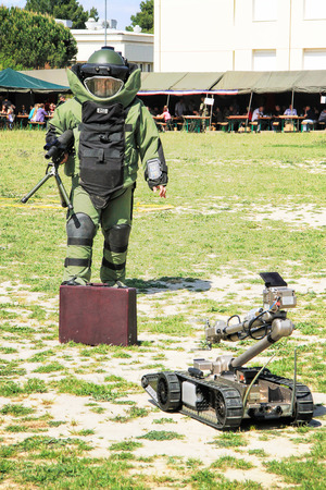 LAUDUN, FRANCE - MAY 01, 2014: Bomb Squad specialiste and vehicle equipped with a remote-controlled robot, detection and detonation equipment during French Foreign legion open Day on May 01, 2014 Editöryel