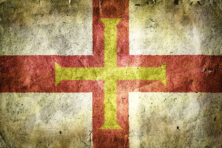 british isles: Flag of Guernsey. Old vintage paper texture.