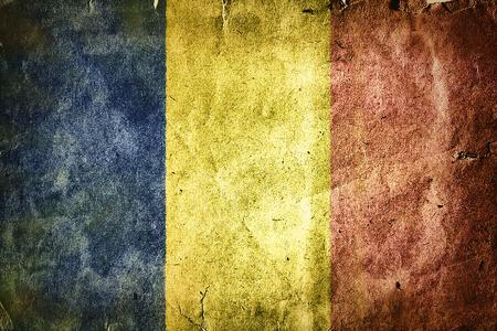 rumania: Flag of Romania. Old vintage paper texture. Stock Photo