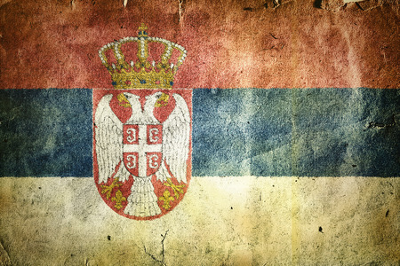 double headed: Flag of Serbia. Old vintage paper texture. Stock Photo