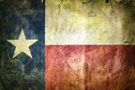 fortress: flag of the state of Texas. Old vintage paper texture. Stock Photo