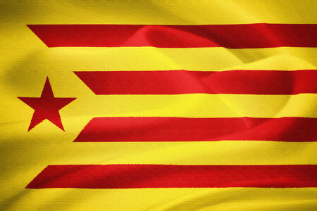 separatism: The flag of Catalonia waving in the wind. Silk pattern texture