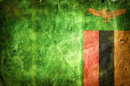 zambian flag: flag of Zambia. Old vintage paper texture. Stock Photo
