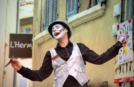 AVIGNON, FRANCE JULY 19, 2014: Actor on stilts advertising his performance during famous theatre festival from July 4 to 27, 2014 in Avignon, south of France.