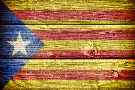 catalonian: flag of Catalonia painted on old grungy wooden  background Stock Photo