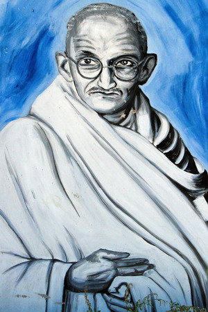 mahatma: SETE, FRANCE  - SEPTEMBER 21, 2014: Graffiti portrait of  Mahatma Gandhi - the Indian father of the nation on the wall of Sete, south of France. Editorial