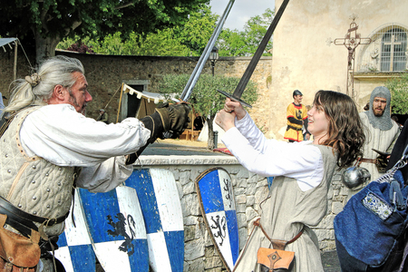 MONDRAGON, FRANCE - JUNE 01, 2013: Historical Reconstruction of the Medieval knights Tournament during a free medieval festival held in the south of France on summer.