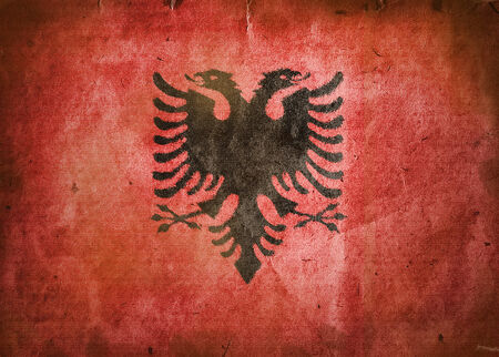 double headed eagle: Flag of Albania. Old vintage paper texture. Stock Photo