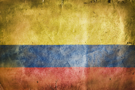 sawed: flag of Colombia. Old vintage paper texture. Stock Photo