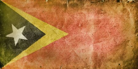 timor: Flag of East Timor. Old vintage paper texture. Stock Photo