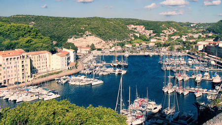 Harbor of Bonifacio -  the oldest town in Corsica extends for some distance along the cliff-tops (the cliffs are listed in the UNESCO world heritage) photo