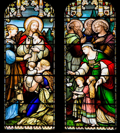 EDINBURGH, SCOTLAND - OCTOBER 02, 2014: Stained glass window illustrated Bible stories in the  St Giles