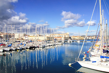 sterility: SETE, FRANCE - JANUARY 31, 2015: Boats in the harbor of Sete with colorful reflections of, captured during winter. Sete - fascinating small town on the French Mediterranean coast Known As The Venice of Languedoc