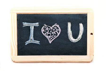 I love you handwritten with colorful chalks on a black chalkboard photo