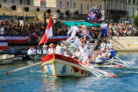 jousting: SETE, FRANCE - August 23, 2014: Water Jousting performance during St.Louis festival at the streets of Sete, South of France on August 23, 2014. Saint Louis is the patronal feast of Seteand also the jousters holiday which offers Six days of non-stop festiv