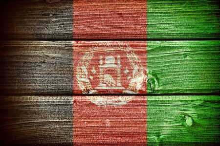 afghan flag: flag of Afghanistan painted on old grungy wooden  background