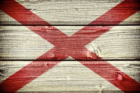 blemish: flag of the state of Alabama painted on old grungy wooden  background