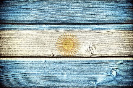 argentum: flag of Argentina painted on old grungy wooden  background Stock Photo