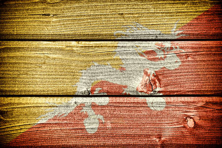 lineage: flag of Bhutan painted on old grungy wooden  background