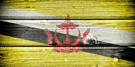 old flag: flag of Brunei painted on old grungy wooden  background