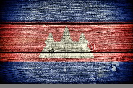 wat: Flag of Cambodia painted on old grungy wooden  background Stock Photo