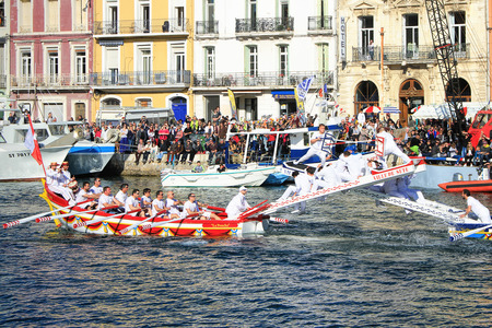 jousting: SETE, FRANCE - March 26, 2016: Water Jousting performance during Stopover in S�te  Maritime Traditions Festival from the 22 to 28 march 2016  at the streets of Sete, South of France