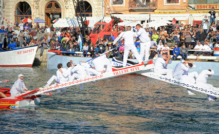 jousting: SETE, FRANCE - March 26, 2016: Water Jousting performance during Stopover in  Maritime Traditions Festival from the 22 to 28 march 2016  at the streets of Sete, South of France