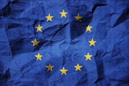 european economic community: flag of the European Union on creased paper - European Crisis Stock Photo