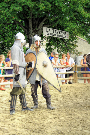 jousting: Chateauneuf-du-Pape, FRANCE - August, 03, 2013: Historical Reconstruction of the Medieval knights Tournament during a free medieval festival held in the famous winemaking village of Chateauneuf-du-Pape, south of France, on summer.