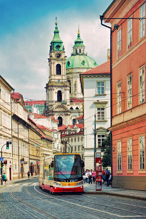 PRAGUE, CZECH REPUBLIC - JUNE 04, 2016: Modern tram goes on old town in Prague Czech Republic. Prague historical centre has an area of 866 hectares and was added to the list of UNESCO World Heritage in 1992 and received over 6 million visitors in year 201
