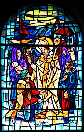 PORTO-VECCHIO, CORSICA, FRANCE - September 12, 2013: Stained glass window in the Church of Porto- Vecchio, Corsica, France