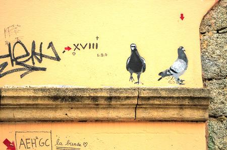 PORTO VECCHIO, FRANCE - September12, 2013: Graffiti  painted pigeons  in Porto Vecchio, Corsica, France