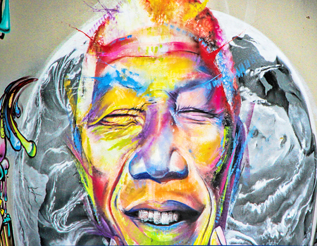 LAUDUN, FRANCE - May 08, 2014: Graffiti face painted on the wall of the Forum sport center in Laudun, south of France. Editorial