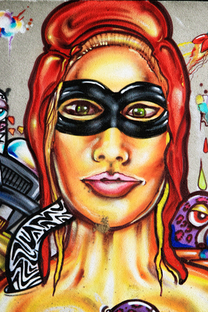 LAUDUN, FRANCE – May 08, 2014: Graffiti  painted girl portrait on the wall of the Forum sport center in Laudun, France