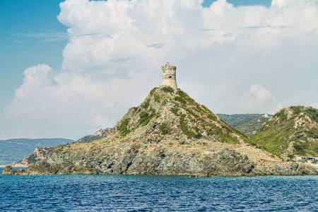 View at Parata cape  (Pointe of Parata) with Genoese Tower and Archipelago of Sanguinaires islands at background, located in the commune of Ajaccio, Corse-du-Sud, on the west coast of the French island of Corsica