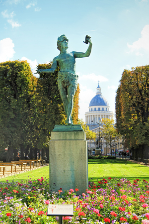 A Greek actor (an ancient statue), against the background of the Pantheon in the Luxembourg Garden Paris. France
