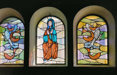 SETE, France –March, 16, 2019: Stained glass window in the Church at the mount Saint Claire, Sete, South of France