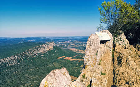 Overwhelming panorama of Hortus mount from Pic Saint-Loup mountain in Languedoc-Roussillon, the highest point of Montpellier, Occitanie, southern France, located near the communes of Cazevieille and Saint-Mathieu-de-Treviers in the Herault department. Stock Photo