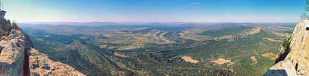Overwhelming panorama of Hortus mount from Pic Saint-Loup mountain in Languedoc-Roussillon, the highest point of Montpellier, Occitanie, southern France, located near the communes of Cazevieille and Saint-Mathieu-de-Treviers in the Herault department Stock Photo