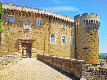 Suze-la-Rousse, France, - July, 16, 2019: Church of Suze-la-Rousse with the Wine university at the vackground, Drome Department, Rhone-Alpes, France