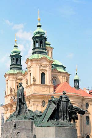 Saint Nicholas church and Jan Hus statue in Prague, Czech Republic.