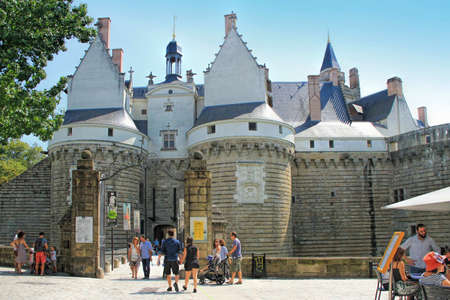 Nantes, France - August, 18, 2018: View on the castle of Dukes of Brittany with tourists in Nantes city in France Editorial