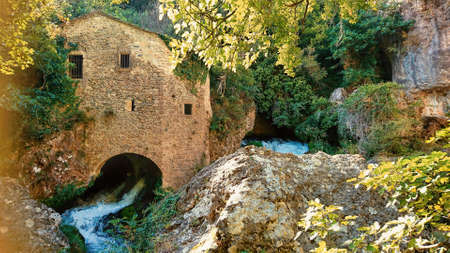 watermill at Vis river in Circus of Navacelles (Cirque de Navacelles) in Cevennes National park. Gard, Herault, France: UNESCO world heritage site. Editorial